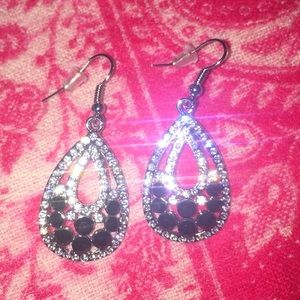 Silver tone clear and black crystal drop earrings.